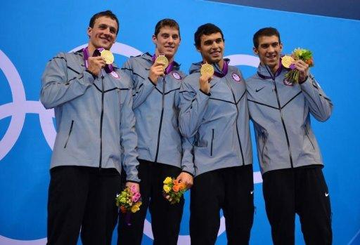 (L-R) US swimmers Ryan Lochte, Conor Dwyer, Ricky Berens and Michael Phelps pose on the podium with their gold medals after winning the men's 4x200m freestyle relay final during the swimming event at the London 2012 Olympic Games in London