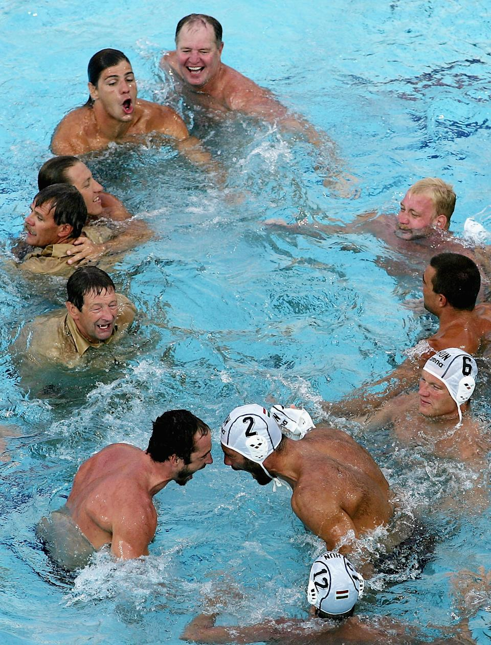 ATHENS - AUGUST 29: The Hungarian team celebrate afer winning the gold medal in the men's Water Polo gold medal game against Serbia Montenegro on August 29, 2004 during the Athens 2004 Summer Olympic Games at the Main Pool of the Olympic Sports Complex Aquatic Centre in Athens, Greece. (Photo by Daniel Berehulak/Getty Images for FINA)