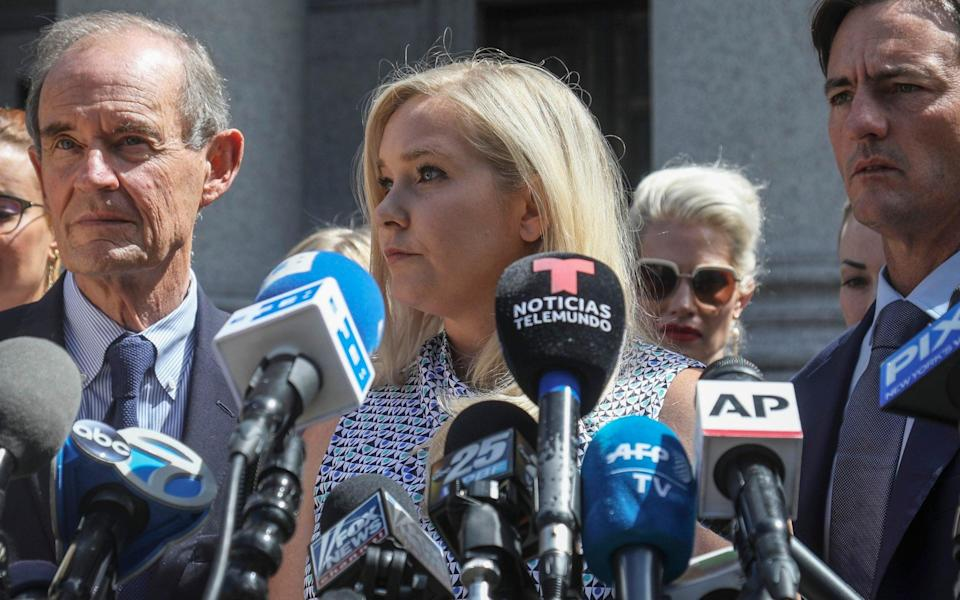 Ms Giuffre, center, who says she was trafficked by sex offender Jeffrey Epstein, holds a news conference in New York - Bebeto Matthews/AP