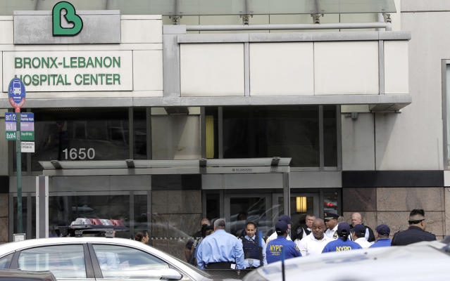 <p>Officials are gathered outside Bronx Lebanon Hospital in New York after a gunman opened fire there on Friday, June 30, 2017. The gunman, identified as Dr. Henry Bello who used to work at the hospital, returned with a rifle hidden under his white lab coat, law enforcement officials said. (AP Photo/Julio Cortez) </p>
