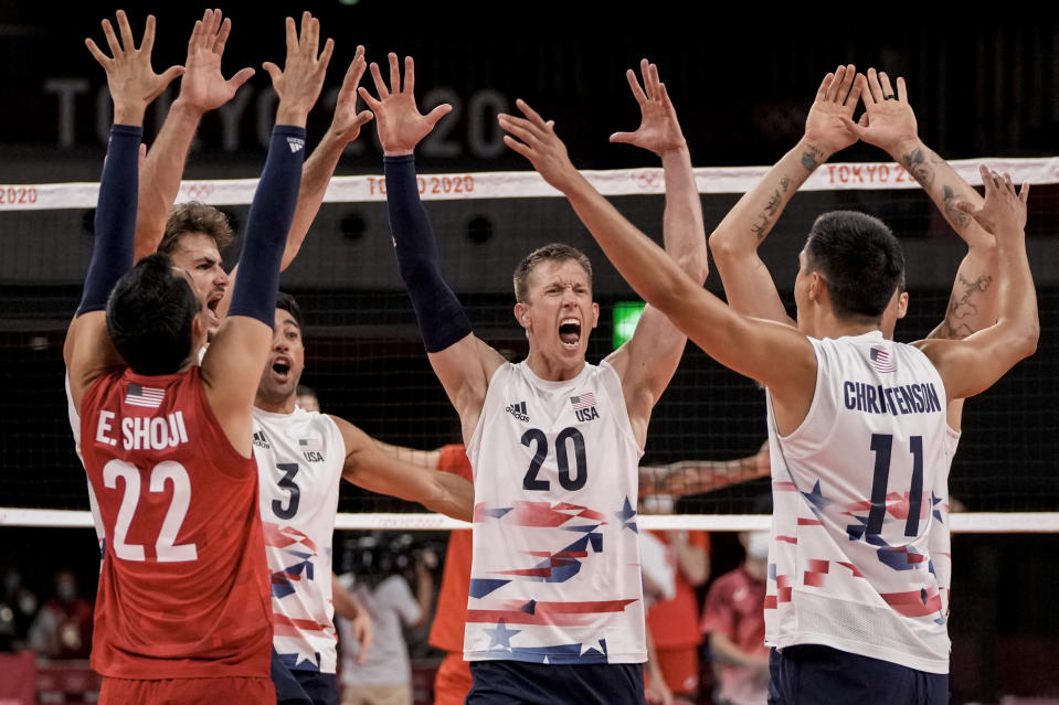 United States' players celebrate a point during the men's volleyball preliminary round pool B match between United States and Russian Olympic Committee at the 2020 Summer Olympics, Monday, July 26, 2021, in Tokyo, Japan. (AP Photo/Manu Fernandez)