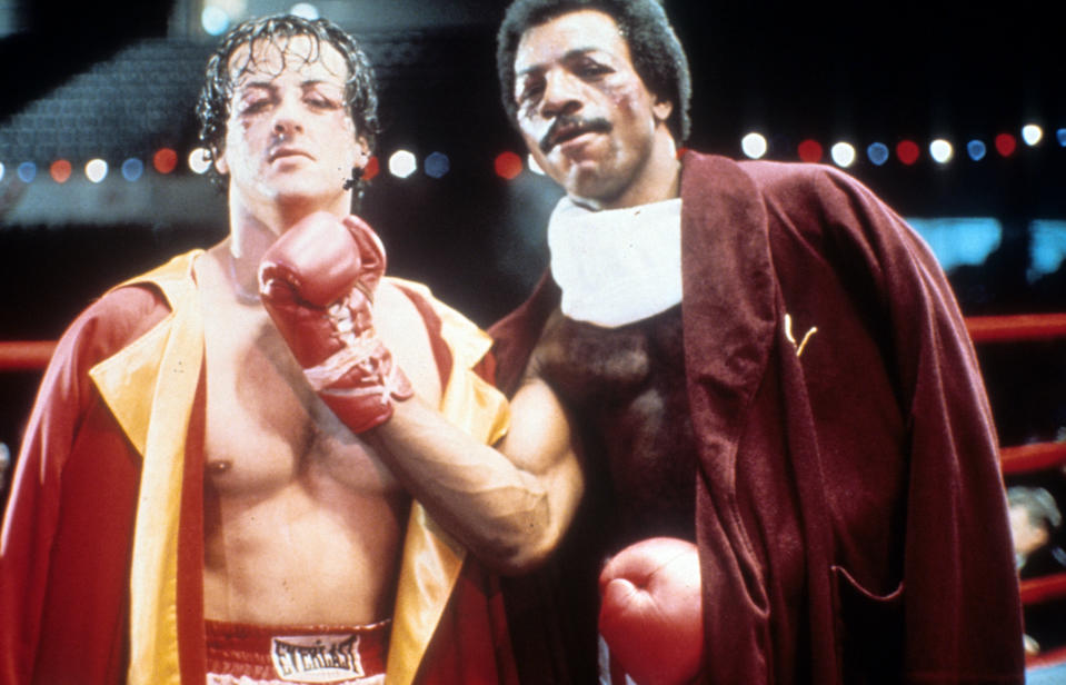 Sylvester Stallone and Carl Weathers on set of the film 'Rocky', 1976. (Photo by United Artists/Getty Images)