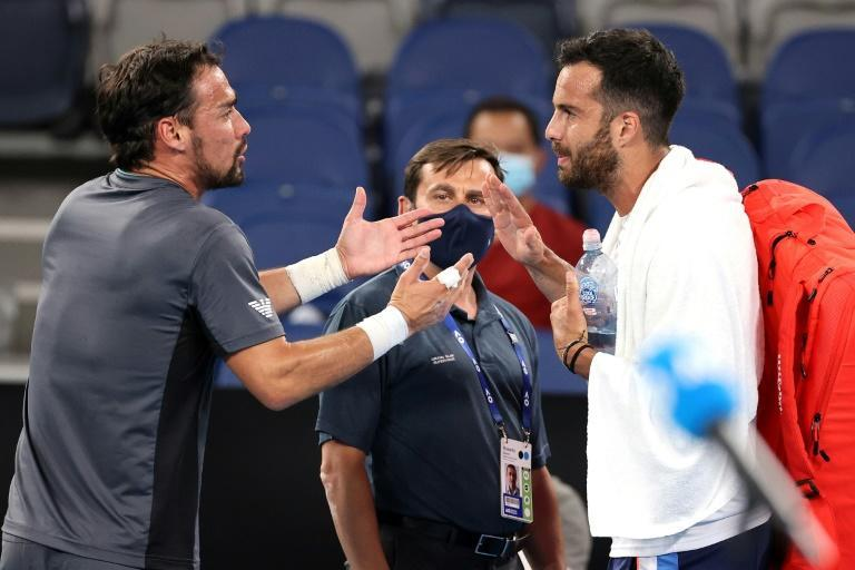 Fabio Fognini (L) and Salvatore Caruso argued after their five-set singles match