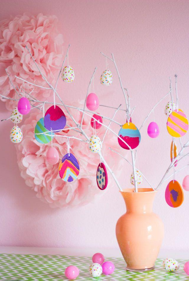 """<p>All you need to make this happy tree are some eggs (have the kids show off their creativity by painting white egg ornaments), a couple of branches from your yard, and a pretty vase!<br></p><p><strong>G</strong><strong>et the tutorial at <a href=""""http://www.designimprovised.com/2016/03/make-easter-egg-tree.html"""" rel=""""nofollow noopener"""" target=""""_blank"""" data-ylk=""""slk:Design Improvised"""" class=""""link rapid-noclick-resp"""">Design Improvised</a>.</strong></p><p><strong><a class=""""link rapid-noclick-resp"""" href=""""https://www.amazon.com/White-Blank-Plastic-Easter-Ornaments/dp/B01G9NVANW?tag=syn-yahoo-20&ascsubtag=%5Bartid%7C10050.g.26498744%5Bsrc%7Cyahoo-us"""" rel=""""nofollow noopener"""" target=""""_blank"""" data-ylk=""""slk:SHOP EGG ORNAMENTS"""">SHOP EGG ORNAMENTS</a><br></strong></p>"""