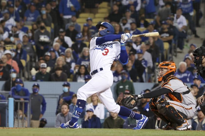 Los Angeles, CA - October 12: Los Angeles Dodgers' Chris Taylor follows through on a swing for a sacrifice fly ball to score Gavin Lux during the second inning in game four of the 2021 National League Division Series against the San Francisco Giants at Dodger Stadium on Tuesday, Oct. 12, 2021 in Los Angeles, CA. (Robert Gauthier / Los Angeles Times)