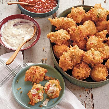 """<p><strong>Recipe:</strong> <a href=""""https://www.southernliving.com/syndication/crab-cake-hush-puppies"""" rel=""""nofollow noopener"""" target=""""_blank"""" data-ylk=""""slk:Crab Cake Hush Puppies"""" class=""""link rapid-noclick-resp"""">Crab Cake Hush Puppies</a></p> <p>We think that hush puppies should be served at every meal. The crab filling in these puppies is light and savory, so your guests will still have plenty of room for the <a href=""""https://www.southernliving.com/recipes/blueberry-pancake-breakfast-casserole-recipe"""" rel=""""nofollow noopener"""" target=""""_blank"""" data-ylk=""""slk:Blueberry Pancake Breakfast Casserole"""" class=""""link rapid-noclick-resp"""">Blueberry Pancake Breakfast Casserole</a>.</p>"""