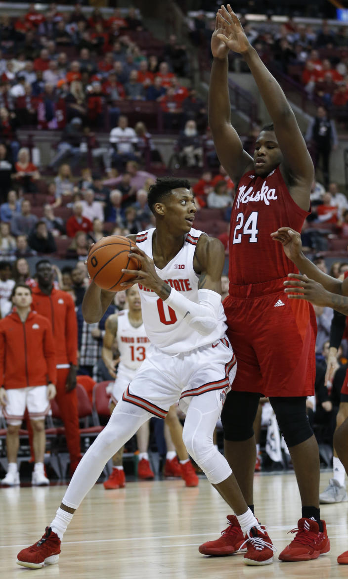 Ohio State's Alonzo Gaffney, left, looks for an open shot as Nebraska's Yvan Ouedraogo defends during the second half of an NCAA college basketball game Tuesday, Jan. 14, 2020, in Columbus, Ohio. Ohio State defeated Nebraska 80-68. (AP Photo/Jay LaPrete)
