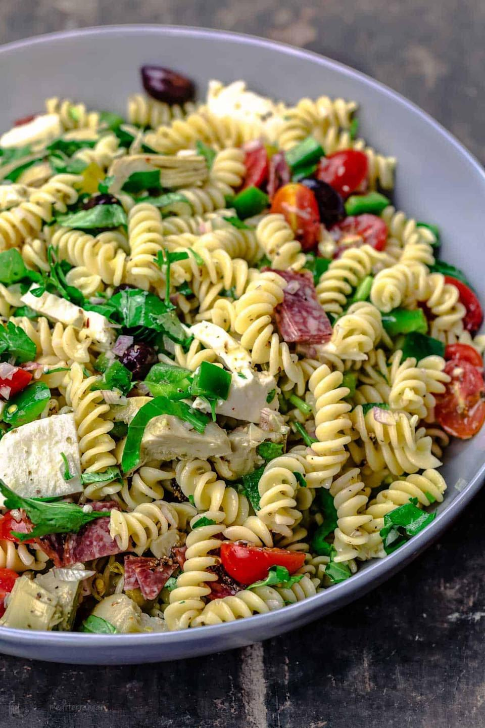 """<p>Made with a homemade sauce that ties all the flavors together, this pasta salad will be your new favorite go-to. Marinate it in the sauce long enough so each bite is packed with flavor. Top it off with your favorite veggies, and you'll be good to go.</p> <p><strong>Get the recipe:</strong> <a href=""""https://www.themediterraneandish.com/italian-pasta-salad/"""" class=""""link rapid-noclick-resp"""" rel=""""nofollow noopener"""" target=""""_blank"""" data-ylk=""""slk:loaded Italian pasta salad"""">loaded Italian pasta salad</a></p>"""