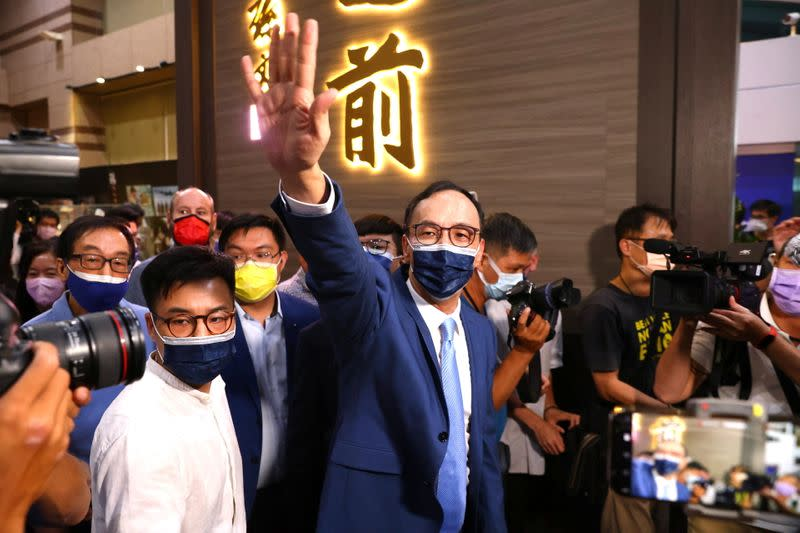 Eric Chu waves to supporters after winning chairmanship of Taiwan's main opposition KMT party, in Taipei