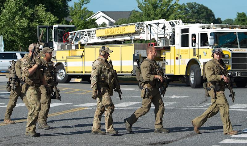 Police responding to a shooting at the Capital Gazette newspaper offices in Annapolis, Maryland, June 28, 2018