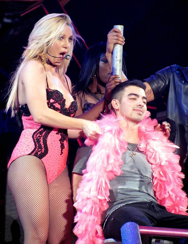 Hubba-hubba! A stripper costume-clad Britney Spears brought fellow pop star Joe Jonas on stage Monday night at London's Wembley Arena during her Femme Fatale tour, where Joe was treated to a racy dance. No word on whether he got to keep the boa as a souvenir. (10/31/2011)