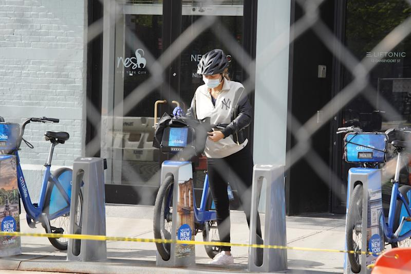 NEW YORK, NEW YORK - MAY 19: A person in protective face mask rents a Citibike on May 19, 2020 in New York City. COVID-19 has spread to most countries around the world, claiming over 324,000 lives with infections of over 4.9 million people. (Photo by Rob Kim/Getty Images)