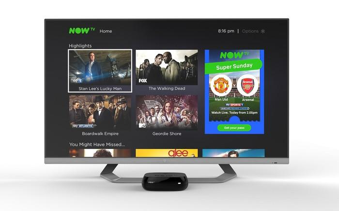 TV showing Roku screen with various content listed.