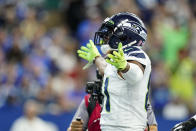 Seattle Seahawks tight end Gerald Everett (81) celebrates a touchdown against the Indianapolis Colts in the first half of an NFL football game in Indianapolis, Sunday, Sept. 12, 2021. (AP Photo/Charlie Neibergall)
