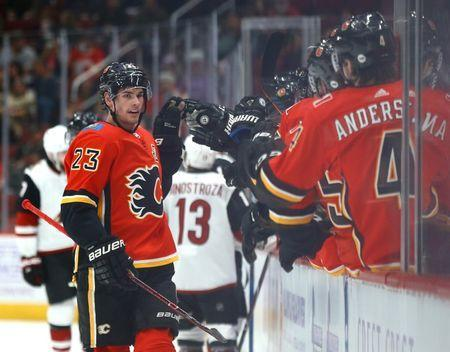 Nov 25, 2018; Glendale, AZ, USA; Calgary Flames center Sean Monahan celebrates with teammates after scoring a goal against the Arizona Coyotes in the first period at Gila River Arena. Mandatory Credit: Mark J. Rebilas-USA TODAY Sports