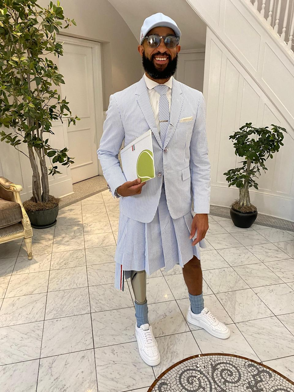 Quin Lewis in a Thom Browne skirt suit
