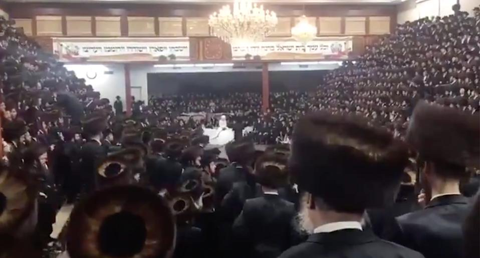 Thousands of people packing a New York synagogue for a wedding during the coronavirus pandemic.