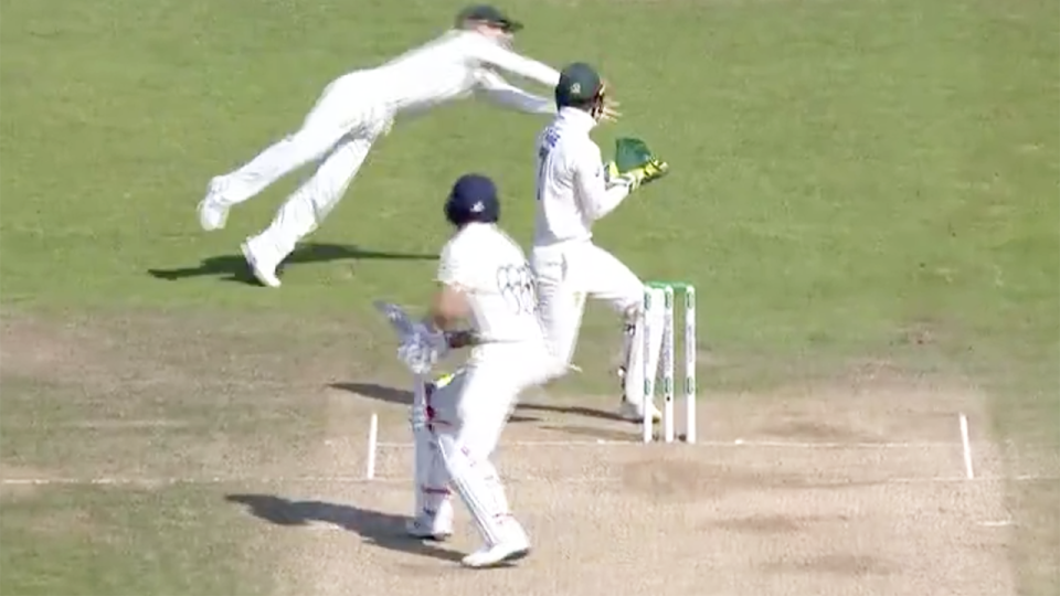 David Warner's incredible diving catch, pictured, dismissed English captain Joe Root for 77.