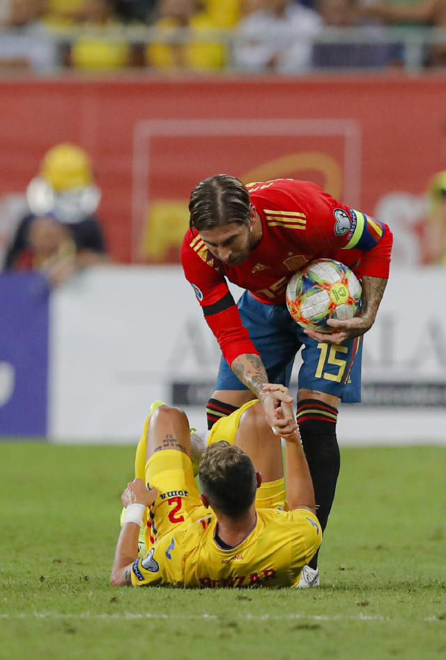 Spain's Sergio Ramos lifts up Romania's Iulian Cristea during the Euro 2020 group F qualifying soccer match between Romania and Spain, at the National Arena stadium in Bucharest, Romania, Thursday, Sept. 5, 2019. (AP Photo/Vadim Ghirda)