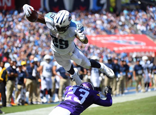 <p>Tennessee Titans running back DeMarco Murray (29) leaps over Minnesota Vikings cornerback Terence Newman (23) for a touchdown during the first half at Nissan Stadium. Mandatory Credit: Christopher Hanewinckel-USA TODAY Sports </p>