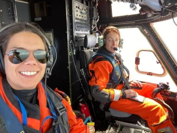 Allison Rumbolt sits next to first officer Zoe Webb aboard Cougar Helicopters' first flight with an all-female crew. (Submitted by Allison Rumbolt - image credit)