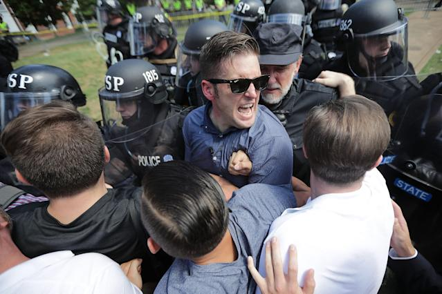 <p>White nationalist Richard Spencer (C) and his supporters clash with Virginia State Police in Lee Park after the 'Unite the Right' rally was declared an unlawful gathering August 12, 2017 in Charlottesville, Virginia. Hundreds of white nationalists, neo-Nazis and members of the 'alt-right' clashed with anti-fascist protesters and police as they attempted to hold a rally in Lee Park, where a statue of Confederate General Robert E. Lee is slated to be removed. (Photo: Chip Somodevilla/Getty Images) </p>