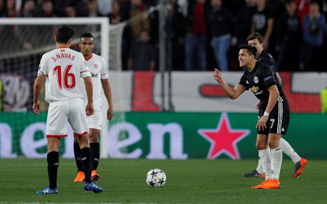 Soccer Football - Champions League Round of 16 First Leg - Sevilla vs Manchester United - Ramon Sanchez Pizjuan, Seville, Spain - February 21, 2018 Manchester United's Alexis Sanchez reacts as Sevilla's Jesus Navas looks on Action Images via Reuters/Andrew Couldridge