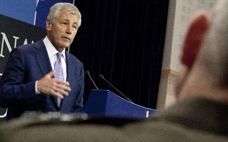 U.S. Defense Secretary Chuck Hagel gestures while speaking during a press conference after a meeting of NATO defense ministers at NATO headquarters in Brussels on Wednesday, June 5, 2013. NATO defense ministers are expected to agree Wednesday on the cornerstones of the alliance's operations in Afghanistan after its combat mission ends in 2014, during a second day of talks in Brussels. (AP Photo/Virginia Mayo)