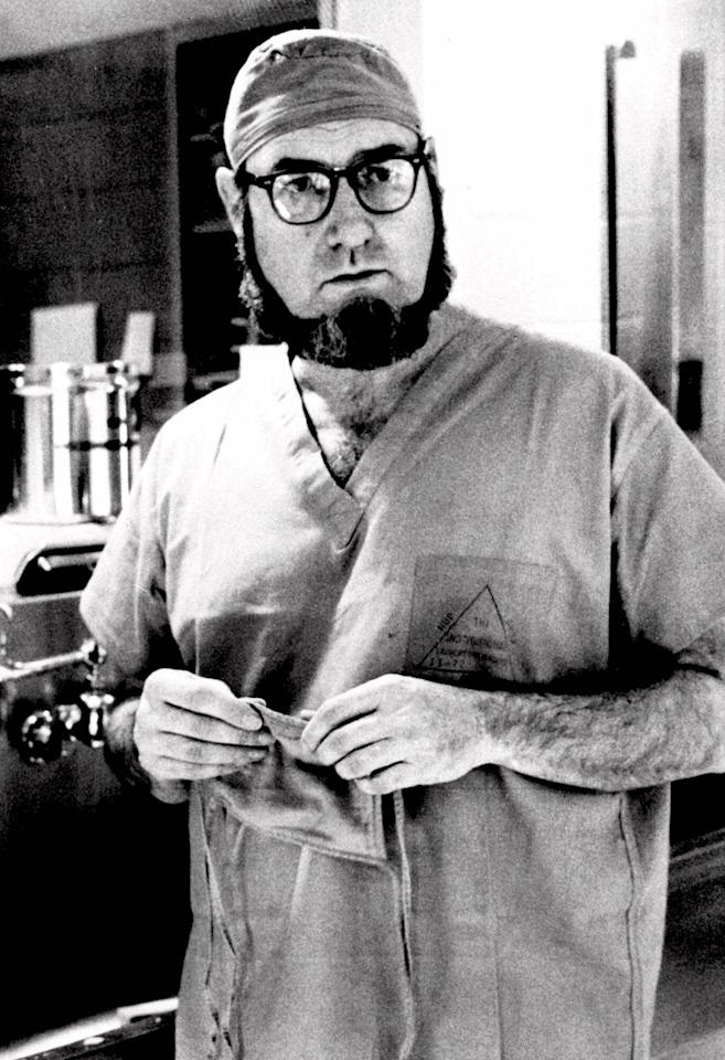 Dr. C. Everett Koop, surgeon-in-chief at Children's Hospital in Philadelphia, talks about surgery that separated 13-month-old siamese twins, Clara and Alta Rodriguez, Sept. 19, 1974.  (AP Photo/William Ingram)