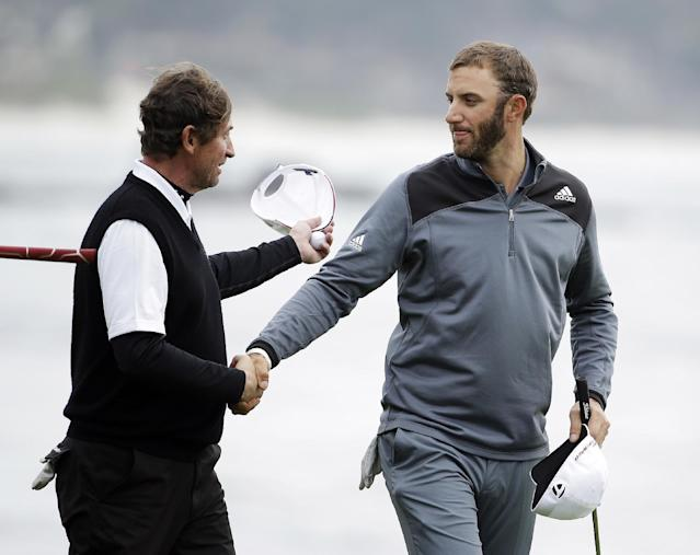 Dustin Johnson, right, is greeted by playing partner Wayne Gretzky, left, on the 18th green of the Pebble Beach Golf Links during the final round of the AT&T Pebble Beach Pro-Am golf tournament Sunday, Feb. 9, 2014, in Pebble Beach, Calif. Johnson finished tied for second place after shooting a 6-under-par 66 to finish at total 10-under-par. (AP Photo/Eric Risberg)