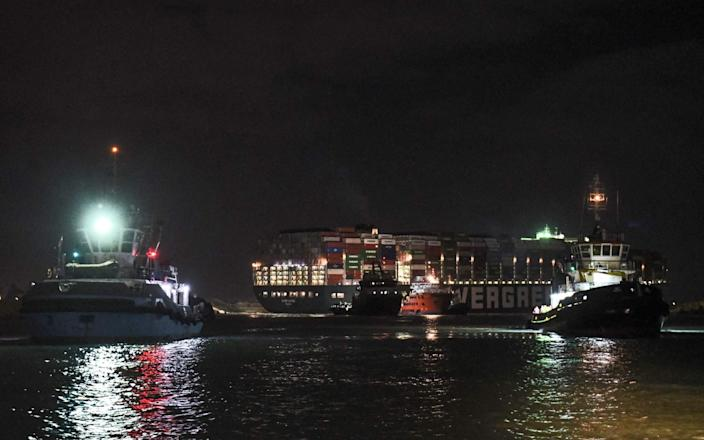 Tugboats have worked through the night to free the Ever Given - AFP