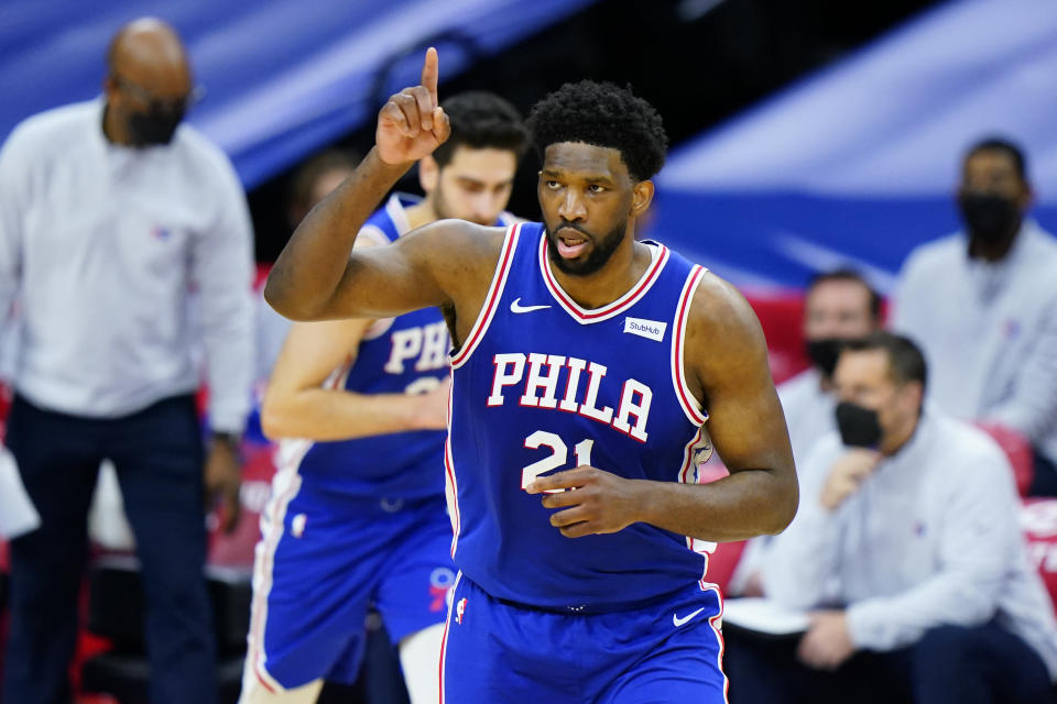 Philadelphia 76ers' Joel Embiid reacts after a basket during the first half of an NBA basketball game against the Indiana Pacers, Monday, March 1, 2021, in Philadelphia. (AP Photo/Matt Slocum)