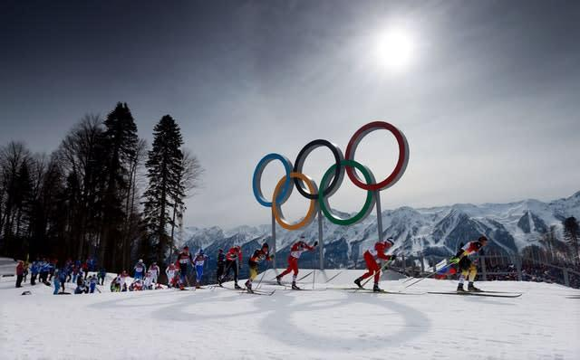 Four-time Olympic gold medallist Dario Cologna during his victory in the men's 30km skiathlon at the 2014 Sochi Winter Olympics. The 27-year-old Swiss athlete, who also won the 15km individual event in Russia, was in second place as the field passed the Olympic rings (David Davies/PA)