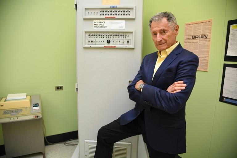 Leonard Kleinrock poses beside the first Interface Message Processor (IMP) in the lab where the first internet message was sent, at the University of California Los Angeles (AFP Photo/Robyn Beck)