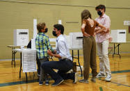 <p>Liberal leader Justin Trudeau votes with the help of his children, left to right, Hadrien, Ella-Grace and Xavier, in his riding of Papineau, Montreal, Que., on Monday, Sept. 20, 2021. THE CANADIAN PRESS/Sean Kilpatrick</p>