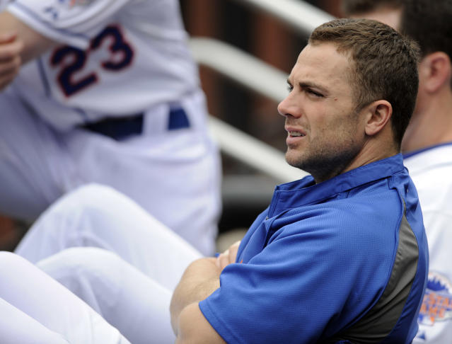 New York Mets' David Wright watches from the dugout during the second inning of an interleague baseball game against the Kansas City Royals Saturday, Aug. 3, 2013 at Citi Field in New York. (AP Photo/Bill Kostroun)
