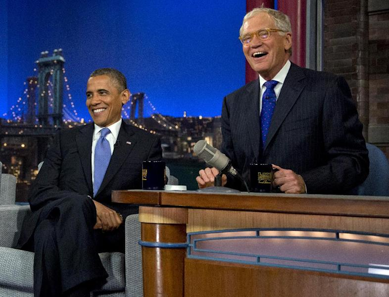 """President Barack Obama sits with David Letterman on the set of the """"Late Show With David Letterman"""" at the Ed Sullivan Theater, Tuesday, Sept. 18, 2012, in New York. (AP Photo/Carolyn Kaster)"""