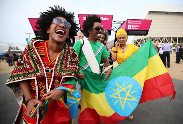 LONDON, ENGLAND - JULY 27: Ethiopia fans enjoy the atmosphere outside the Olympic stadium during the Olympics Opening Day as part of the London 2012 Olympic Games at the Olympic Park on July 27, 2012 in London, England. (Photo by Jeff J Mitchell/Getty Images)