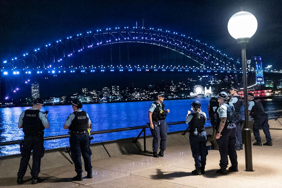 Police are seen at the Sydney Opera House during New Year's Eve celebrations on December 31, 2020.