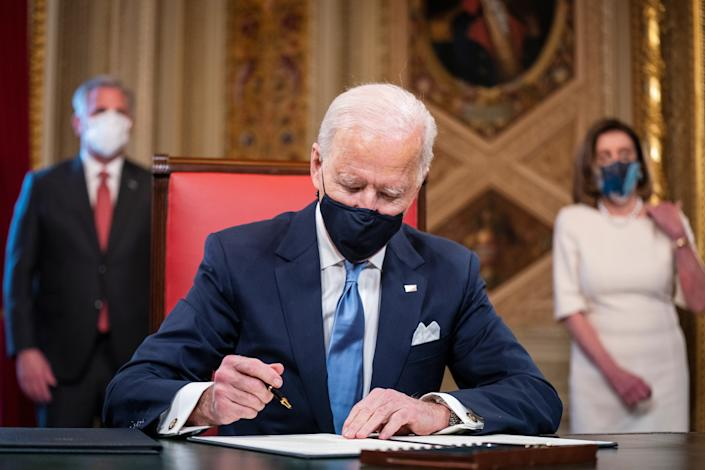 U.S. President Joe Biden signs three documents including an Inauguration declaration, cabinet nominations and sub-cabinet nominations in the Presidents Room at the U.S. Capitol after the 59th Presidential Inauguration. (Jim Lo Scalzo/Pool via Reuters)