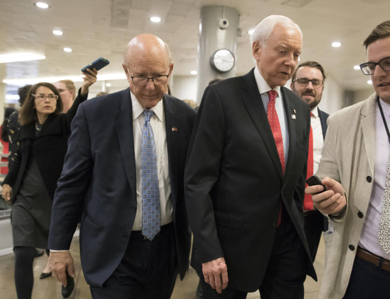 Sen.Pat Roberts, R-Kan., a member of the Senate Finance Committee, walks with Sen. Orrin Hatch, R-Utah, the panel's chairman, during votes at the Capitol in Washington, Thursday, Oct. 19, 2017. (AP Photo/J. Scott Applewhite)