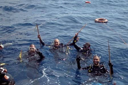Divers prepare to dive to catch lionfish at the Zenobia, a cargo ship wreck off Larnaca