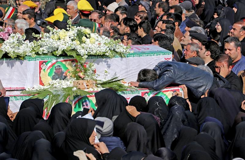 Iranians mourn on February 16, 2019 at the coffins of Revolutionary Guards members killed in a suicide attack