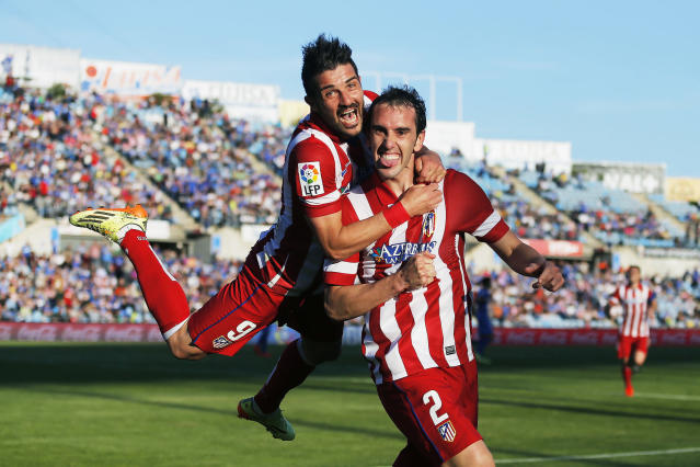 <p>Atlético Madrid's Diego Godin, right, celebrates a goal with teammate David Villa during a Spanish La Liga soccer match with Getafe CF at the Coliseum Alfonso Pérez in Madrid, April 13, 2014. (AP Photo/Andres Kudacki) </p>