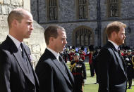 From left, Prince William, Peter Phillips and Prince Harry walk in a procession behind the coffin of Prince Philip, during the funeral of Britain's Prince Philip inside Windsor Castle in Windsor, England, Saturday, April 17, 2021. Prince Philip died April 9 at the age of 99 after 73 years of marriage to Britain's Queen Elizabeth II. (Chris Jackson/Pool via AP)
