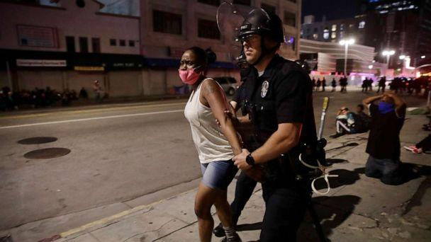 PHOTO: FILE - In this May 31, 2020, file photo, a police officer arrests a woman as protests over the death of George Floyd continued in Los Angeles.  (Jae C. Hong/AP, File)