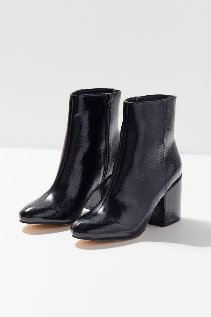 """<strong><h3>Urban Outfitters Margo Patent Boot</h3></strong><br><strong>Why It's A Best Buy</strong>: These high-shine ankle boots are crafted from polished faux leather in the coveted pointed-toe and block-heel style of the moment — all for a shockingly good under-$80 price. <br><br><strong>The Review</strong>: """"Obsessed. I am in love with these shoes, they are very crisp so they need to be worn down a little bit. Perfect heel and super comfy. They fit my feet like a dime!""""<em> – Urban Outfitters Reviewer</em><br><br><strong>UO</strong> Margo Patent Boot, $, available at <a href=""""https://go.skimresources.com/?id=30283X879131&url=https%3A%2F%2Fwww.urbanoutfitters.com%2Fshop%2Fuo-margot-patent-boot"""" rel=""""nofollow noopener"""" target=""""_blank"""" data-ylk=""""slk:Urban Outfitters"""" class=""""link rapid-noclick-resp"""">Urban Outfitters</a>"""