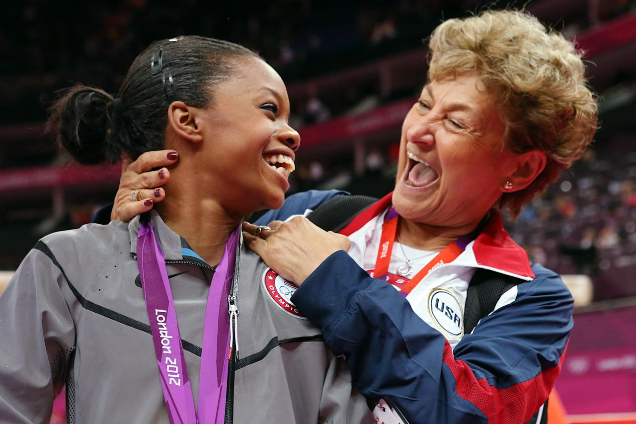 Gabrielle Douglas of the United States celebrates winning the gold medal with team coordinator Martha Karolyi after the Artistic Gymnastics Women's Individual All-Around final on Day 6 of the London 2012 Olympic Games at North Greenwich Arena on August 2, 2012 in London, England.  (Photo by Ronald Martinez/Getty Images)