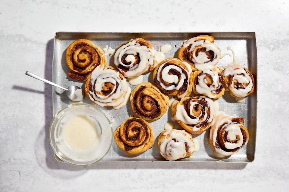 """<p>I haven't gone so far as to time it, but I do think these cinnamon buns can be whipped up in the time it would take you to get your sleepy self along to a bakery to pick up a few for brunch.</p> <p>Unlike most cinnamon buns, these are not made with a yeasted bread base, so there's no waiting around while the dough rises, or struggling to shape a dough that can sometimes be unruly; just a quick mix and a pat out of a very cooperative dough and you're on your way to heaven.</p> <a href=""""https://www.epicurious.com/recipes/food/views/quick-and-easy-cinnamon-buns-reynolds?mbid=synd_yahoo_rss"""" rel=""""nofollow noopener"""" target=""""_blank"""" data-ylk=""""slk:See recipe."""" class=""""link rapid-noclick-resp"""">See recipe.</a>"""
