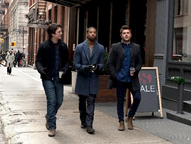 "This image released by Focus Features shows, from left, Miles Teller, Michael B. Jordan and Zac Efron in a scene from ""That Awkward Moment."" The film is expected to be the top-grossing film this weekend, from what is expected to be a mostly female audience. (AP Photo/Focus Features, Nicole Rivelli, file)"